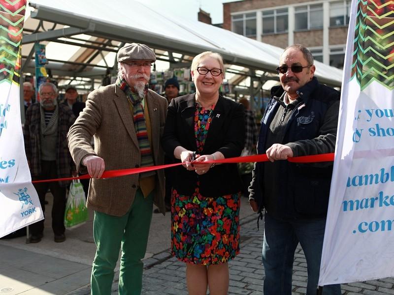 Traders Dave Magginnis (far left) and Gordon David (far right) help Cllr Crisp open Shambles Market